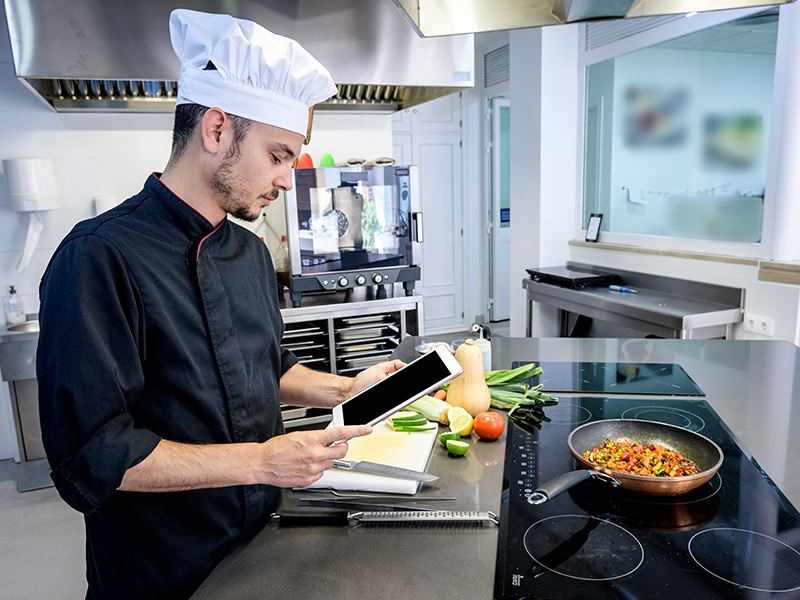 chef looking at ipad